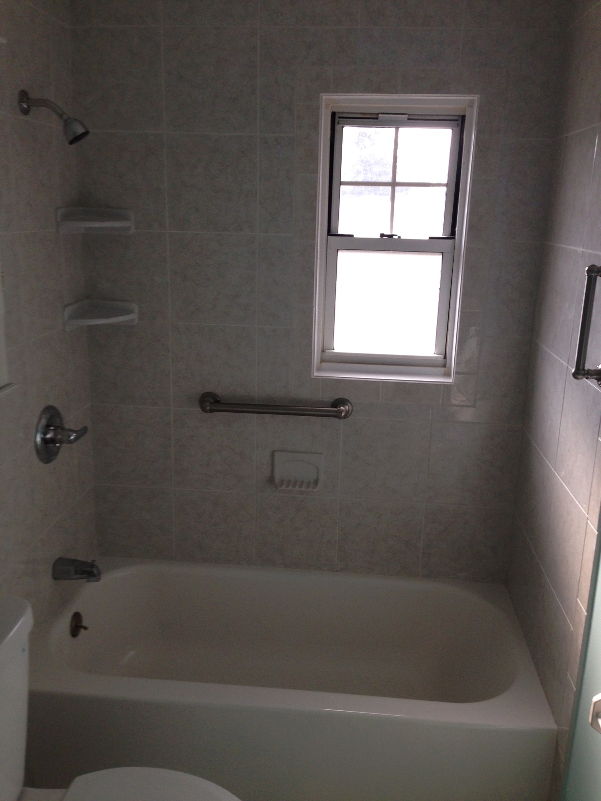 Tile work in bathrooms - Next Image